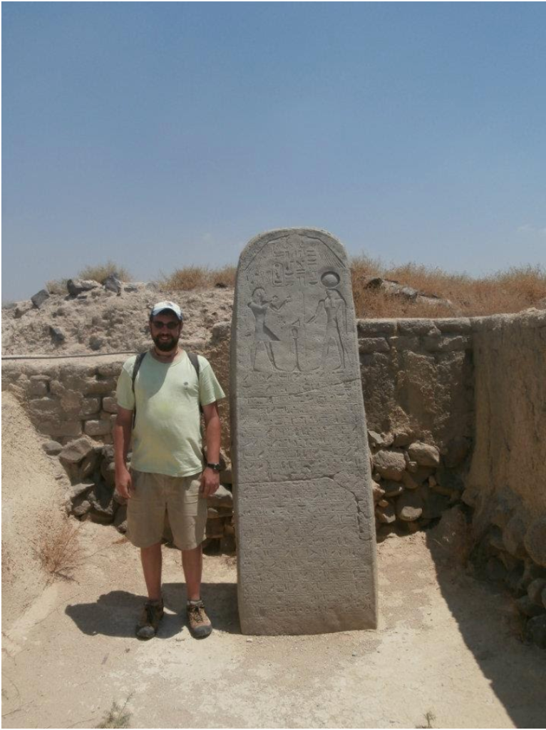 The author at the Late Bronze Age Egyptian Governor's House at Beit She'an (Stela is a replica)